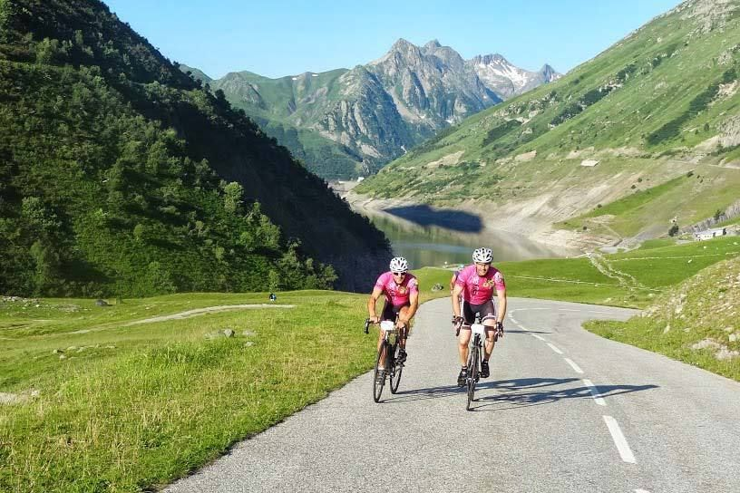 Riding above the Lac du Grand Maison on the way up the Col de la Croix de Fer
