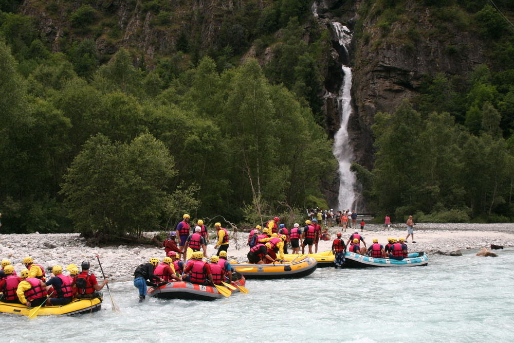 White water rafting heading to waterfall for dunking